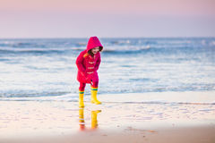 Child on North Sea beach in winter Royalty Free Stock Images