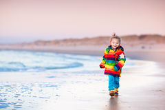 Child on North Sea beach in winter Stock Photography