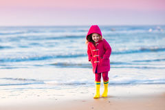 Child on North Sea beach in winter Royalty Free Stock Photos