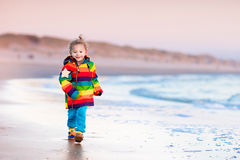 Child on North Sea beach in winter Royalty Free Stock Photography