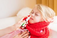 Child with nose spray. Sick child with nose spray Royalty Free Stock Photo
