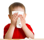 Child nose wiping with tissue. Isolated Royalty Free Stock Photos