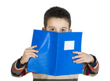 Child with notebook in front of the face Stock Photography