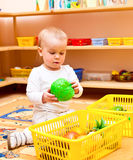 Child at nursery. Little baby girl playing with toys at nursery Royalty Free Stock Photo