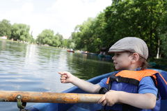 Child with an oar Stock Photo