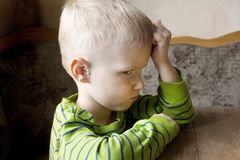 Child offended and unhappy. Sad offended unhappy worried little child (boy) close up portrait Royalty Free Stock Image