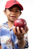 Child offering apple stock images
