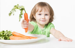 Child offers carrots. Healthy Eating Stock Photography