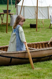 child and old canoe Royalty Free Stock Images