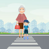 Child with old lady in the crosswalk Royalty Free Stock Photo