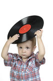 Child with an old LP records. Child, holding an old vinyl record in his hands Stock Photo