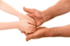 Child and old man hands Stock Photos