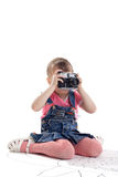 Child with old-style film photo camera Royalty Free Stock Image