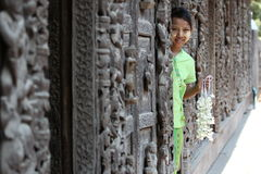 Child with flowers in Myanmar Stock Image