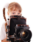 Child with old wood large format digital camera. royalty free stock images