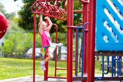 Free Child On Monkey Bars. Kid At School Playground Royalty Free Stock Photo - 140282315