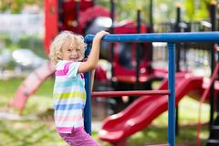Free Child On Monkey Bars. Kid At School Playground Stock Photo - 140282440