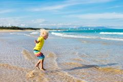 Free Child On Tropical Beach. Sea Vacation With Kids. Stock Images - 102630894