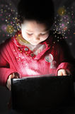 Child open a box at dark Royalty Free Stock Photo