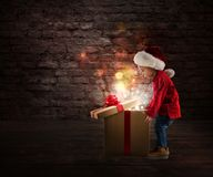 Child that open a magic Christmas gift royalty free stock photography