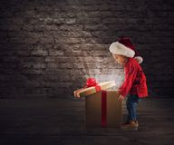 Child that open a magic Christmas gift royalty free stock images