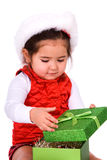 Child opening christmas gift. Royalty Free Stock Image