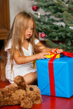 Child opening Christmas presents Royalty Free Stock Photography