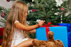 Child opening Christmas presents Royalty Free Stock Photo