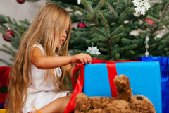 Child opening Christmas presents Royalty Free Stock Images