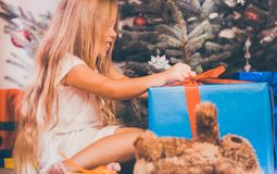 Child opening Christmas presents Stock Images