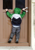 Child opening door Stock Photos