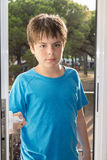 Child opening a door Stock Photos