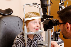 Child opening eyes wide for examination Royalty Free Stock Photography