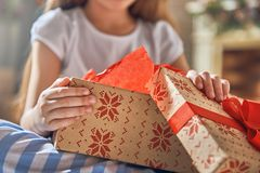 Child opening gift. Happy holidays! Cute little child opening gift at Christmas. Close up Stock Images