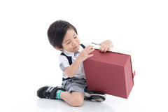 Child opening gift present box on white background Royalty Free Stock Images