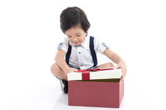 Child opening gift present box on white background Royalty Free Stock Photos