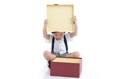 Child opening gift present box on white background Stock Photo