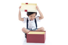 Child opening gift present box on white background. Cute Asian child opening gift present box on white background isolated Royalty Free Stock Images
