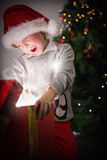 Child opening his christmas present Royalty Free Stock Photography