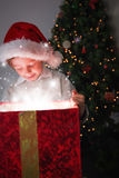 Child opening his christmas present Royalty Free Stock Photos