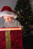 Child opening his christmas present Royalty Free Stock Images