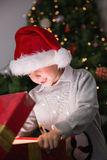 Child opening his christmas present Royalty Free Stock Photo