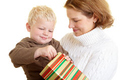 Child opening present Stock Photography