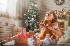 Child opening present Stock Photos