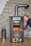 Child opening wood fired stove Stock Images