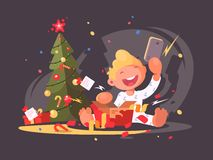 Child opens Christmas present. Royalty Free Stock Image