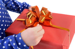 Child opens Gift red box Royalty Free Stock Photo
