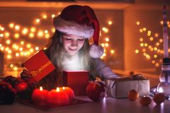 Child opens a New Year`s gift stock image
