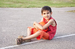Child with orange ball Royalty Free Stock Images