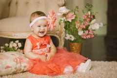 The child in an orange dress Stock Photo